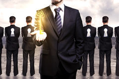 Right approach ethics. Businessman holding ornate golden key. Row of businessmen with keyholes in backs on landscape background. Right approach ethics concept royalty free stock photos