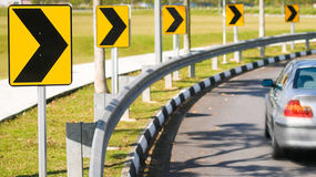 Right Bend in Road. Series of chevrons arrows indicating a bend in a road Royalty Free Stock Photography