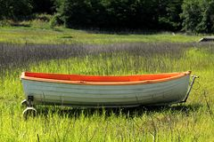 The right boat to sail. A quiet field where I find a strange transport Royalty Free Stock Image