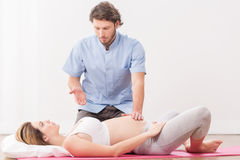 Right breathing relief pain. Pregnant women exercising with instructor in antenatal classes Royalty Free Stock Photo