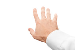 Right business man hand trying to grab something. First-person view with selective focus isolated on white stock photography