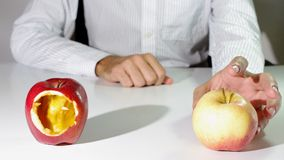 Right choice. Represented by the correct apple chosen Stock Photos