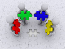 Right color for puzzle completion. Four 3d people holding different puzzle pieces standing on puzzle with missing piece Stock Photography