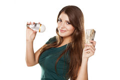 The right decision. Smiling girl shows how you can save money with LED bulb Stock Photos