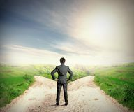 The right destination. Concept with businessman at crossroad stock photo