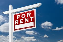 Right Facing For Rent Real Estate Sign Over Blue Sky and Clouds. With Room For Your Text stock image