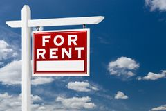 Right Facing For Rent Real Estate Sign Over Blue Sky and Clouds. With Room For Your Text royalty free stock images