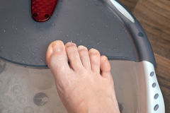 Right foot pampering pedicure otmokaet in a specialized foot Spa with massage effect.  Stock Images