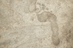 Right foot prints in concrete cement Royalty Free Stock Image