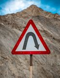 Right hair pin bend sign road safety mountain roads. Triangle, attention, accident, brake, car, warning, icon, dangerous, black, hazard, street, traffic, red royalty free stock photography
