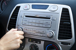 Car Stereo - Adjusting the Volume Royalty Free Stock Image