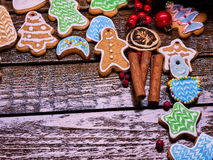 Right-hand angle of Christmas cookies on wooden table. Royalty Free Stock Photo