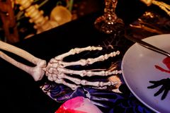 Right hand bone on tableware,Halloween day.  royalty free stock image