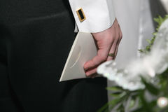 Right hand business man with a white envelope Royalty Free Stock Photography