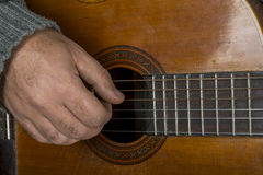 Right hand on the guitar Royalty Free Stock Images