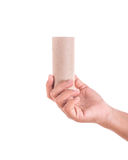 Right hand holding brown paper tube isolated on white background Royalty Free Stock Photography