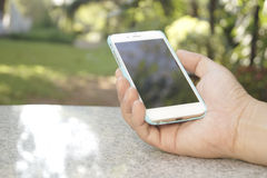 Right hand holding a smart phone Stock Photo