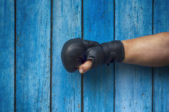 Right hand of the man in boxing gloves Royalty Free Stock Photo