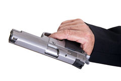 Aiming Loaded Gun - Close Up. The right hand of a mature adult man wearing a suit, holding a 9mm gun in sideways position, aiming it to the target Stock Photography