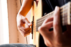 Right hand picking guitar Stock Images
