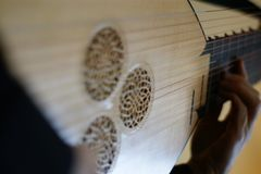 Playing the lute right hand rosette baroque lute stock images