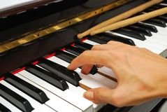 Right hand playing on piano keyboard Stock Image