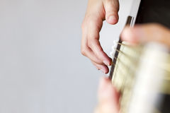 Right hand playing some guitar strings. Stock Photo