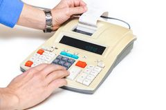 Hand presses cash register keys another takes out check Stock Photos