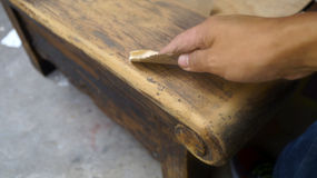 Free Right Hand Using Sandpaper For Wood Restauration Stock Image - 59582631