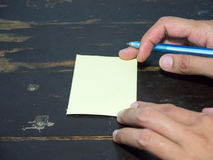 Right hand write post it note Royalty Free Stock Photo