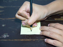 Right hand write post it note stock photos