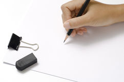 Right hand writing on paper Stock Image