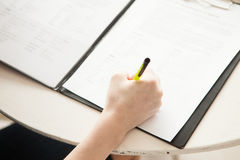 A right hand writing on paper Royalty Free Stock Image