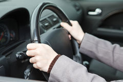 Right hands position on steering wheel. During driving a car Royalty Free Stock Photography