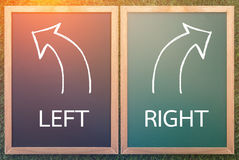 Right left and arrow drawn with chalk on a blackboard Stock Images