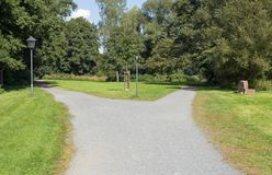 Right or left. A fork in the road in a public park Stock Photo