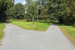 Right or left. A fork in the road in a public park Stock Image