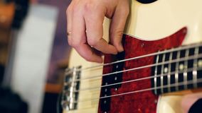 Right male hand playing bass guitar stock video
