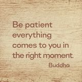 Right moment Buddha wood. Be patient everything comes to you in the right moment - famous quote of Gautama Buddha printed on grunge wooden board royalty free stock photo