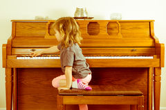 Right note requires effort outside a comfort zone. Right note requires effort outside your comfort zone in a conceptual image with a little girl climbing on the stock images