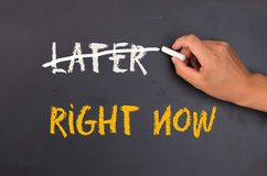 Right now not later. On chalkboard Stock Image