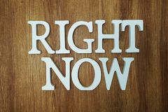 Right Now Word alphabet letters on wooden background. Right Now Word alphabet letters with space copy on wooden background royalty free stock images