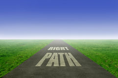 Right path. Following the right path concept with open road leading towards the horizon royalty free stock photo