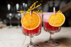 Вright raspberry cocktail decorated with orange Royalty Free Stock Photography