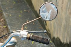 Right rear mirror and hand bar with brake system of vintage Japanese motorcycle.  stock image