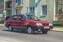 Classic Polish car Polonez 1500 driving. Right side and front view of Polish classic red Polonez 1500 driving on a street on sunny day in Gdansk, Poland stock photos