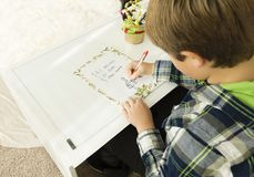 A boy writing a letter to Santa Claus royalty free stock photos