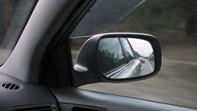 The right side mirror in a car stock video