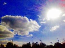 Right sunshiny day. Clouds sunshiny shun shine Royalty Free Stock Photography