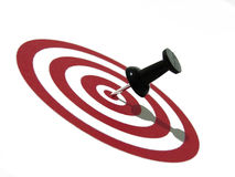 Right on target. Red bullseye and black pin Stock Image